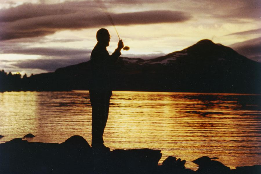 Hans van Klinken fly fishing during midsummernight at the Hodalen Lakes in Norway