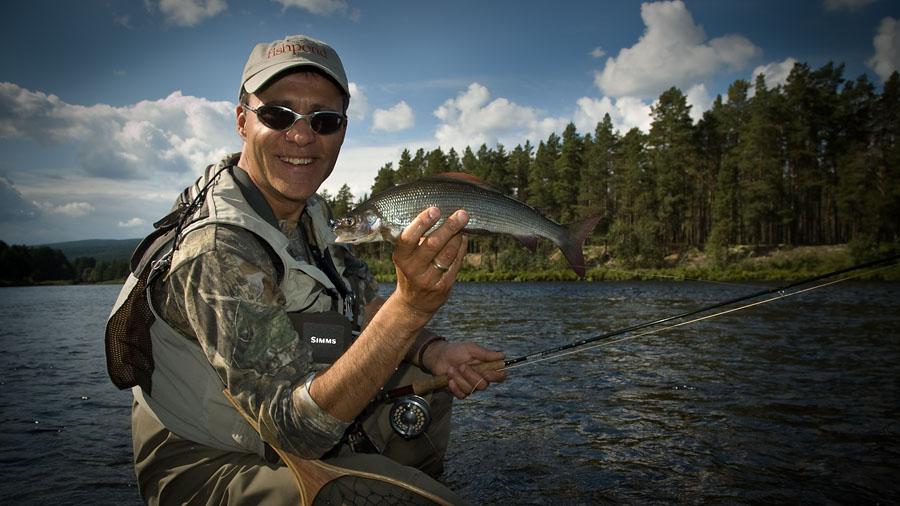 Matt Hayes shows a nice Glomma grayling at Kvennan Fly Fishing