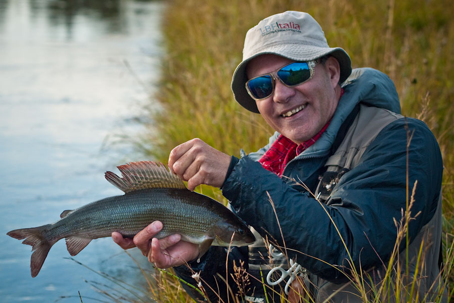 Matt Hayes fly fishing for grayling on a beautiful autumn day in Norway