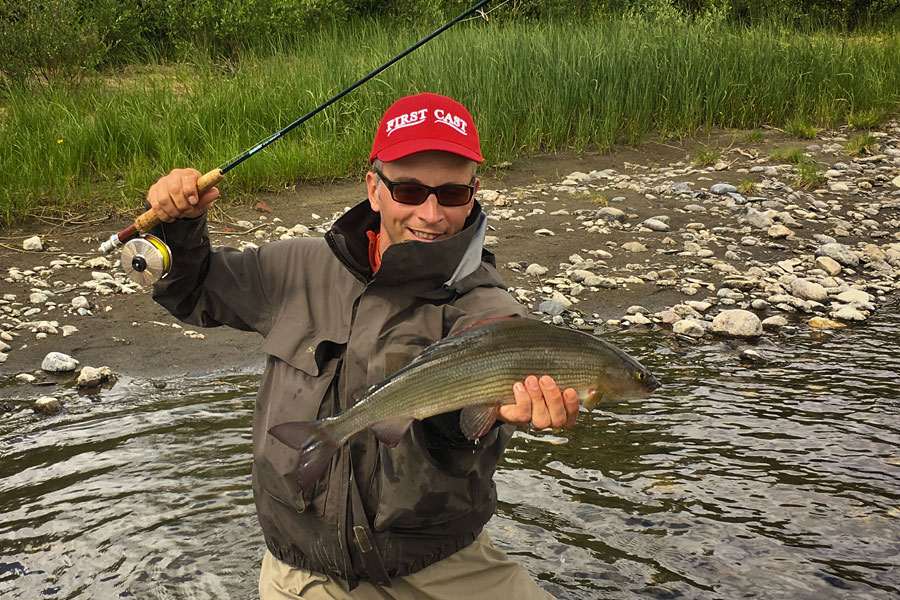 Bernd Ziesche shows a lovely grayling from river Glomma at Kvennan Fly Fishing